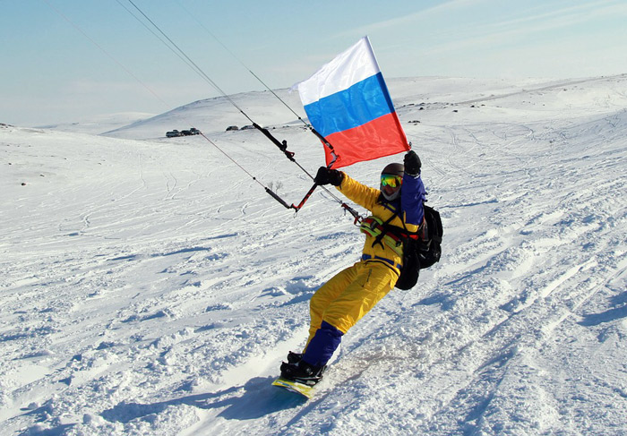 Kite surfer flying the Russian flag