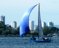 blue sailing boat on river